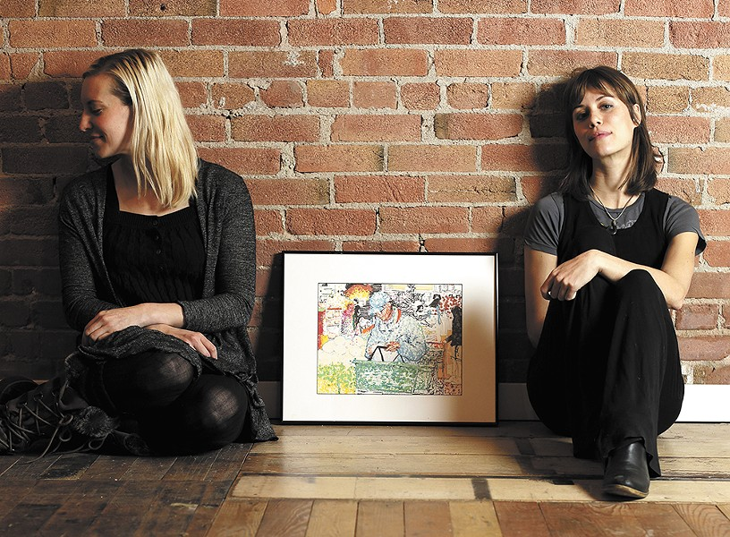 "Richmond Art Collective co-founders Rebecca Chadwell, left, at Anne-Claire Mitchell at the gallery with Nile Livingston's piece ""Finding Inspiration at the Market."" - YOUNG KWAK"
