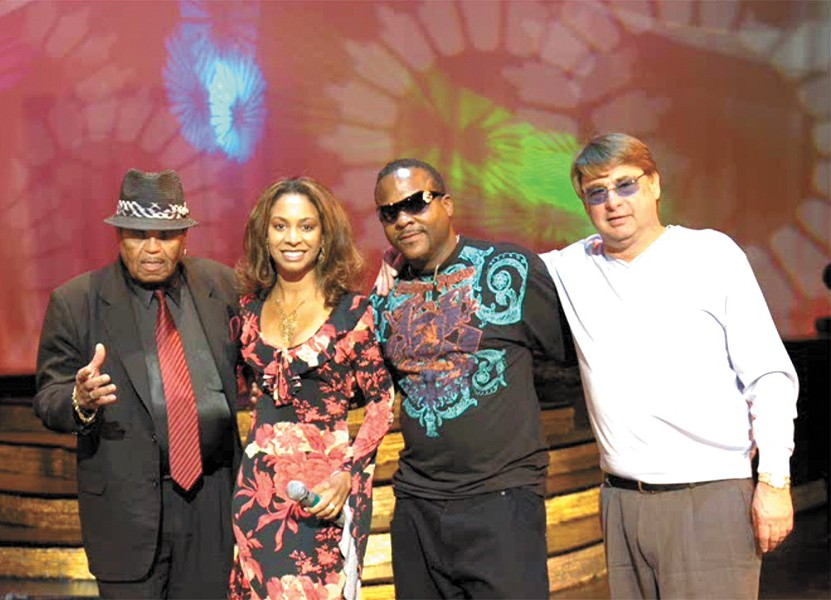 Erick Hansen (right) posed for a photo in the Bahamas with Michael Jackson's dad (far left) a few years before Hansen pleaded guilty to fraud. - PHOTO PROVIDED BY ROY HAHN