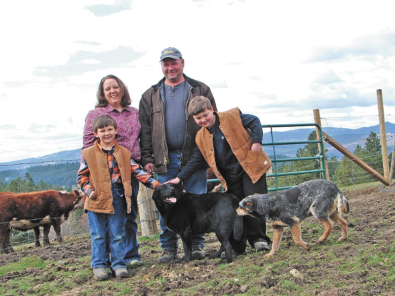 Kay and Mike Teisl, seen here with sons Tanner (left) and Michael, operate Cross-Cut Farms. - CARRIE SCOZZARO