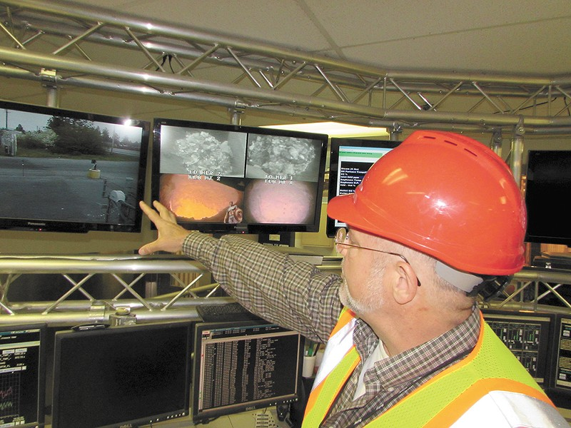 Solid Waste Disposal Director Chuck Conklin inside the facility's command center. - DANIEL WALTERS