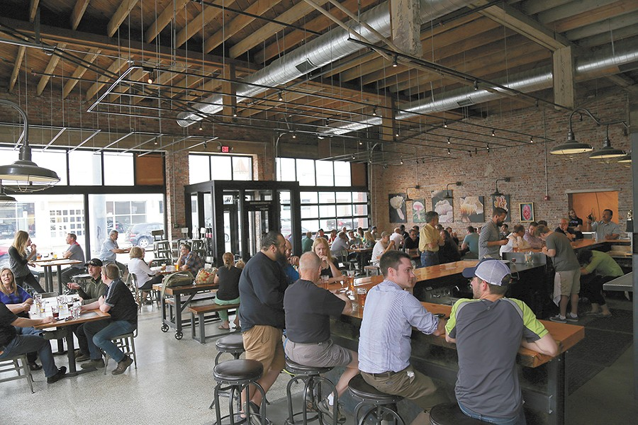 Iron Goat Brewing Co.'s new brewery and restaurant on the west side of downtown has been an instant hit since opening in mid April. - SARAH PHILP