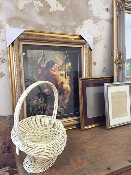 A display of art and frames inside the shop. - ALYSSA AGEE