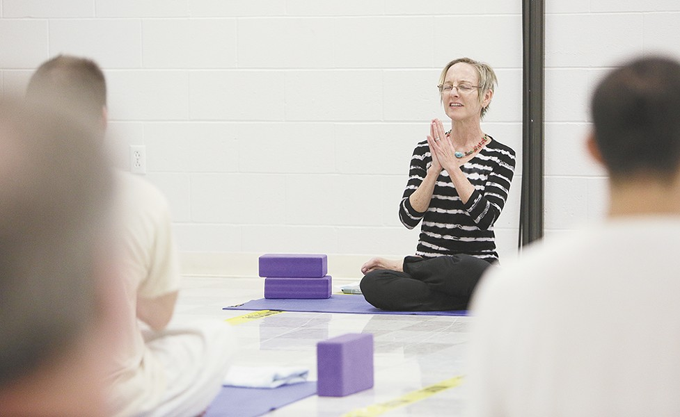 "Diane Sherman says inmates find a ""lovely opening into humanity"" at her yoga classes. - YOUNG KWAK"