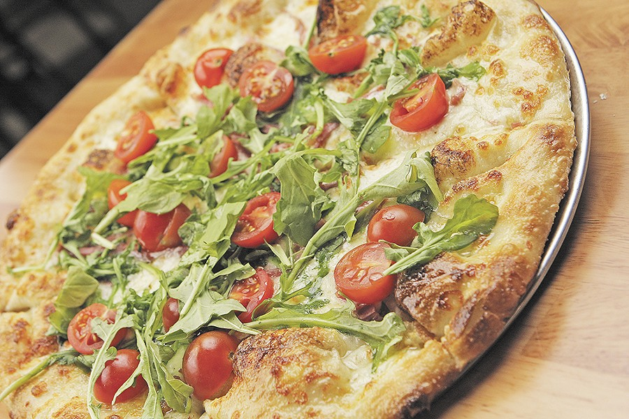 South Perry's prosciuto pizza is finished with fresh arugula and cherry tomatoes. - YOUNG KWAK