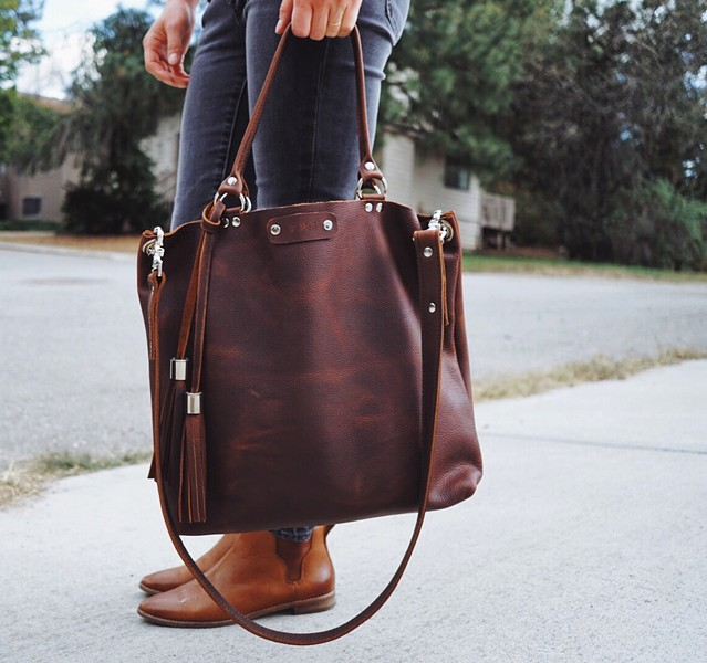 Teddi Cripps makes this tote bag and many other designs at her home studio. - HUSTLEANDHIDECO.COM