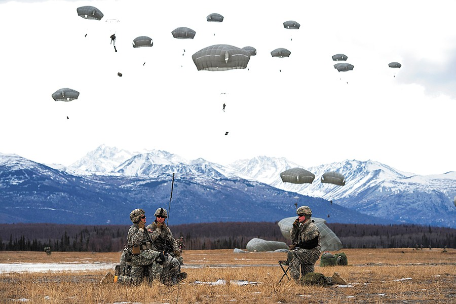 Paratroopers assigned to the 4th Infantry Brigade Combat Team practice a forced-entry parachute assault at a base in Alaska as part of a larger tactical field exercise. - U.S. AIR FORCE/ALEJANDRO PENA PHOTO