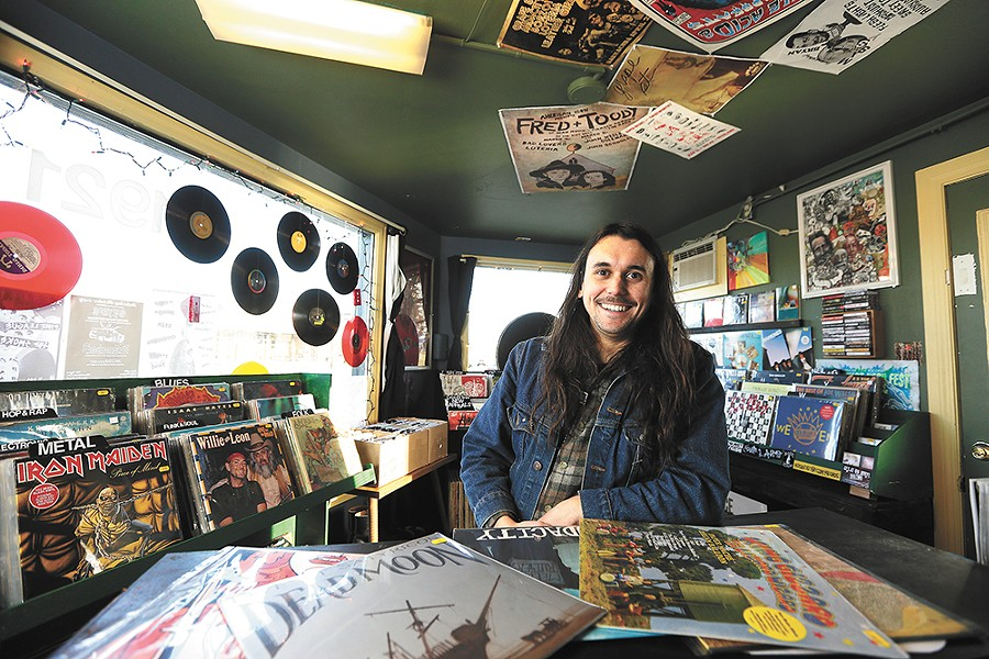 Mike Roberts shows off the entirety of his compact Resurrection Records shop. - YOUNG KWAK