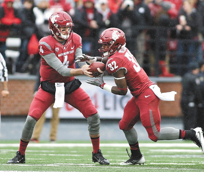 Washington State quarterback Luke Falk and running back James Williams hope to lead the Cougars offense to a win against Minnesota. - YOUNG KWAK