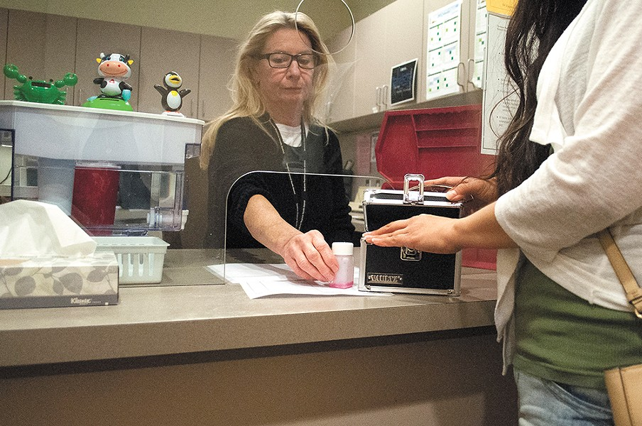 A nurse at the Spokane Regional Health District dispenses methadone to a patient. | SARAH PHILP photo