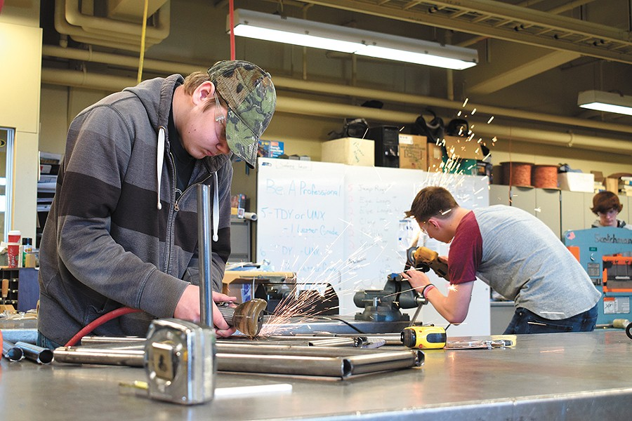 Wyatt Eitreim (left) welds in the shop at Shadle Park High School. - WILSON CRISCIONE