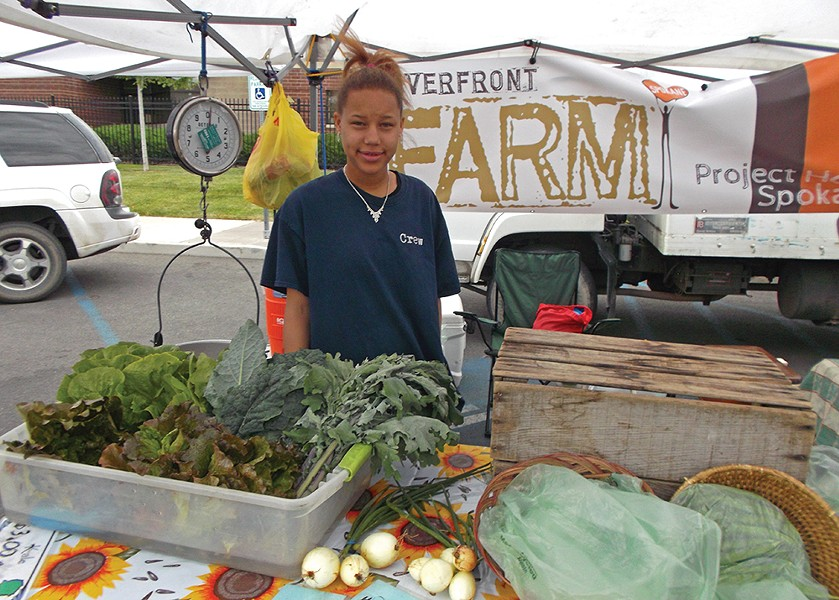 Monicea Brown sells locally grown vegetables at the the Kendall Yards Night Market.