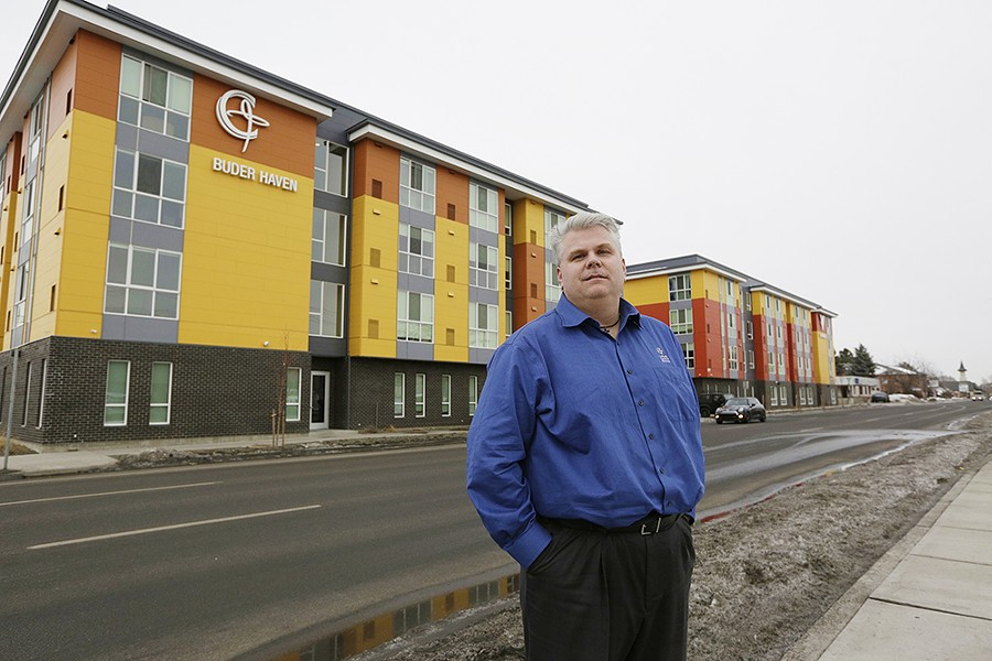 Catholic Charities CEO Rob McCann in front of the new Buder Haven.