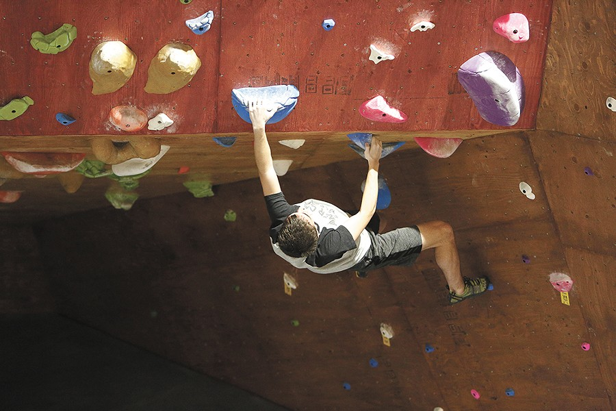 Rock climbing is skyrocketing in popularity, and bouldering-style climbing is a great way to build strength for outdoor climbs, Bloc Yard manager Brett Jessen says. - YOUNG KWAK