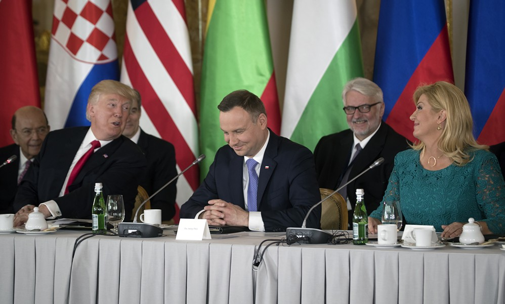 "From left: President Donald Trump, Poland's President Andrzej Duda and Croatia's President Kolinda Grabar-Kitarović during a summit of the Three Seas Initiative, at the Royal Castle in Warsaw, Poland, July 6, 2017. Trump, delivering a stark message to a friendly Polish crowd before a two-day G-20 summit, cast the West's battle against ""radical Islamic terrorism"" as a way to protect ""our civilization and our way of life."" - STEPHEN CROWLEY/THE NEW YORK TIMES"