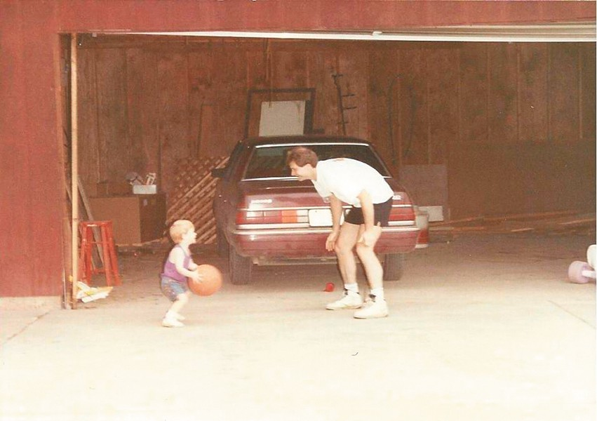 Cossey playing ball with his son, Tyler, in an undated family photo.