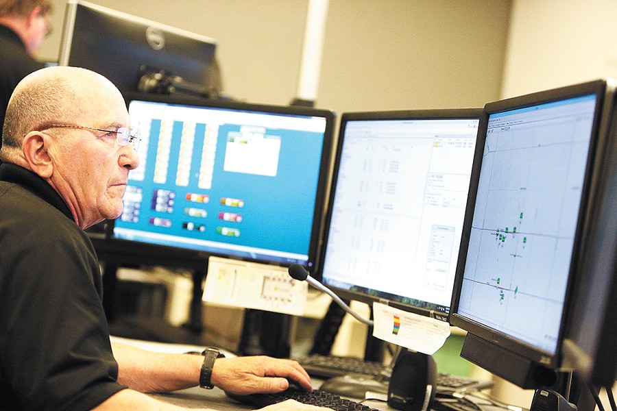John Schlabach monitors buses around all the city from the Spokane Transit Authority communications center. - YOUNG KWAK
