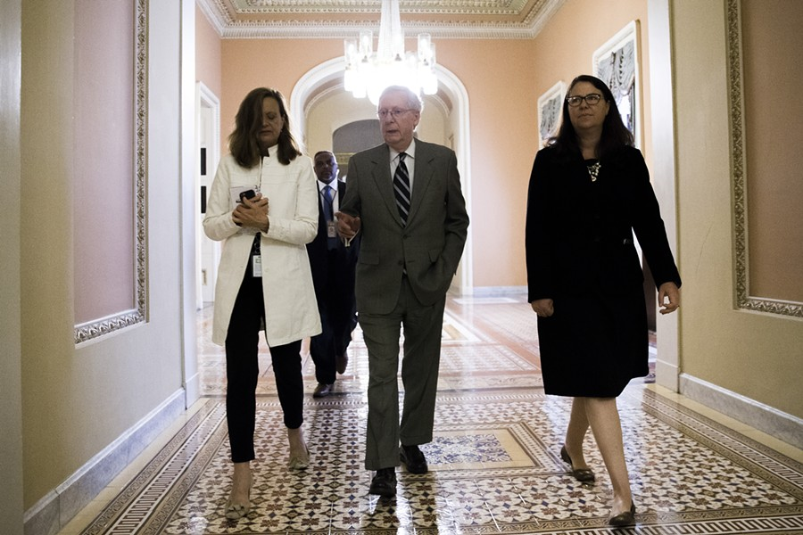 Senate Majority Leader Mitch McConnell (R-Ky.) walks with members of his staff on Capitol Hill in Washington, July 20, 2017. After seven months of deliberation, Republicans have reached the moment when they have to vote on repealing the Affordable Care Act, but they have yet to be told precisely what they will be voting on. - TOM BRENNER/THE NEW YORK TIMES