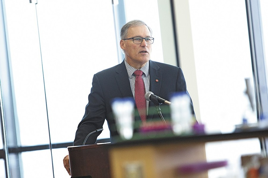 """In his 2013 inaugural address, Gov. Jay Inslee referenced the December 2012 Sandy Hook massacre, calling for a solution to gun violence that would likely """"involve mental health and keeping guns out of the wrong hands, while respecting the right of my son to hunt and my uncle to defend his home."""" - YOUNG KWAK PHOTO"""