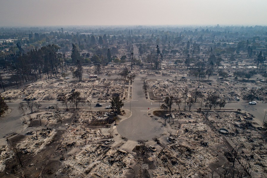 An aerial view of homes burned by wildfire in the Coffey Park neighborhood of Santa Rosa, Calif., Oct. 10, 2017. Fires which began just two days prior had by Tuesday burned about 115,000 acres over eight counties in California's wine country; at least 15 people are dead and some 2,000 structures are damaged or destroyed. - JOSH HANER/THE NEW YORK TIMES