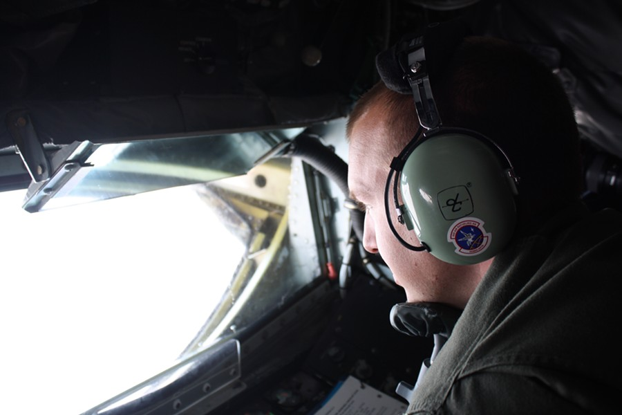 Staff Sgt. Travis Peirce uses a chin rest and mirrors as he guides a fuel boom with two joysticks from the belly of a KC-135 on Thursday. - SAMANTHA WOHLFEIL PHOTO