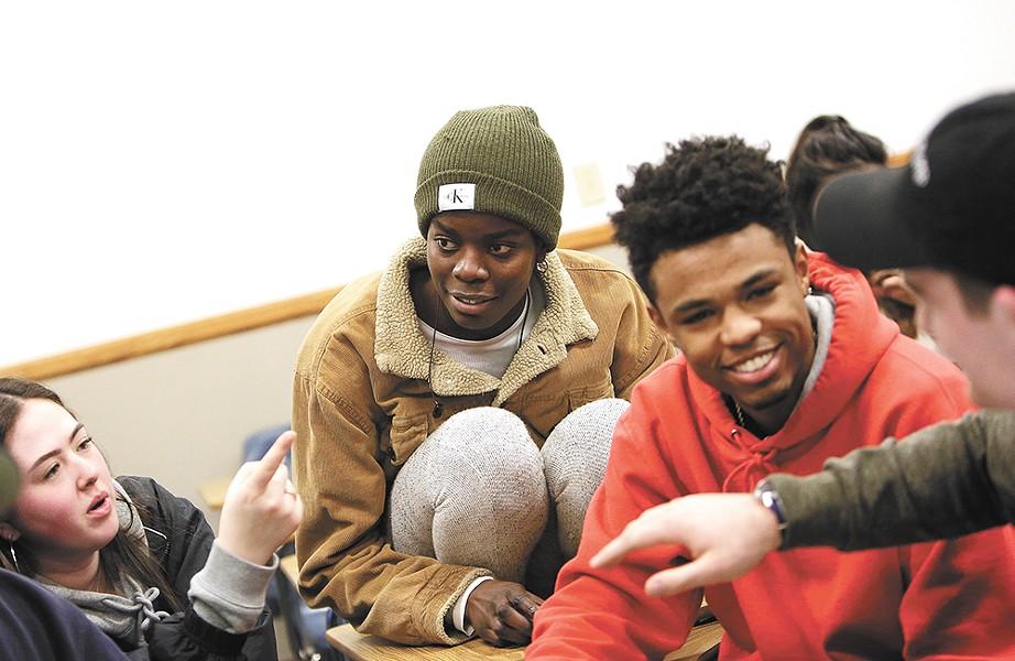 From left: Freshman Olivia Isarankura, junior Aminat Oladunjoye, freshman Malcolm Duncan and sophomore Kevin Hance. - YOUNG KWAK