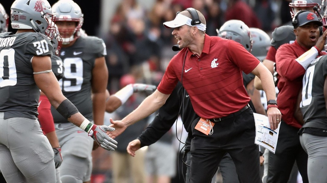 "Alex Grinch has driven his ""Speed D"" to new heights in his third year as Washington State's defensive coordinator; the Cougars' aggressive defense ranks among the nation's best with 94 tackles for loss, 27 turnovers forced and 35 sacks. - WSU ATHLETICS"