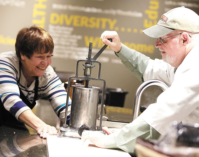 Hodge teaches how to make a breakfast sausage during a recent beginner's class hosted by Second Harvest Food Bank. - YOUNG KWAK