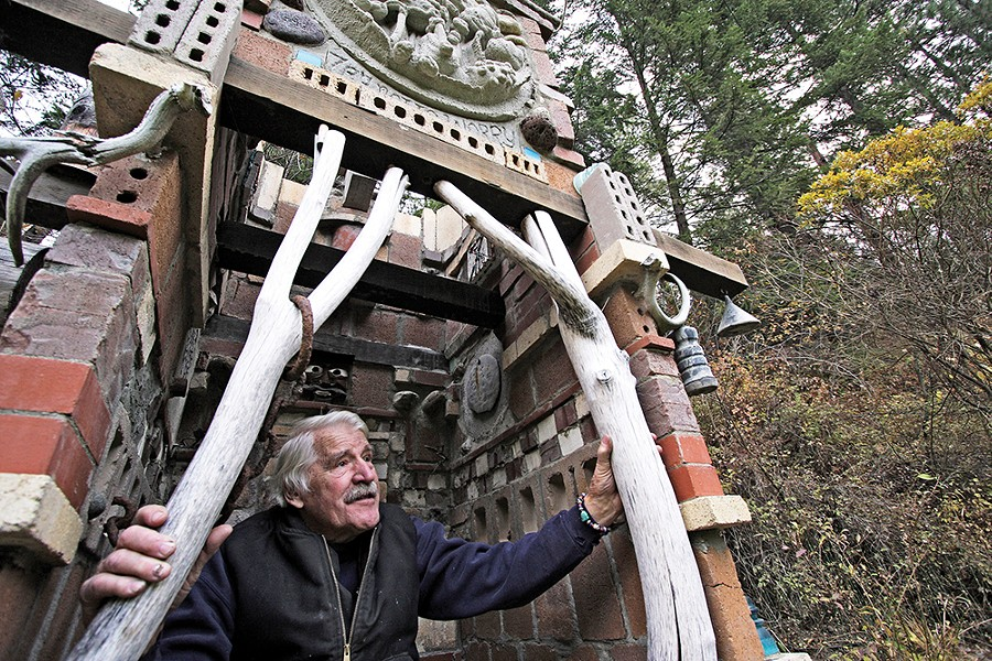 Harold Balazs explores one of his sculptures on his property in 2008. - YOUNG KWAK