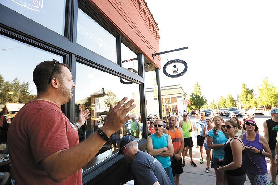 Runners gather outside the Lantern Tap House in the Perry District for a Tuesday evening run. - YOUNG KWAK