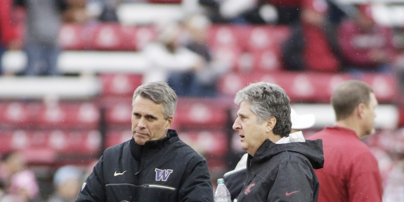 Apple Cup 2016 Washington head coach Chris Petersen, left, and Washington State head coach Mike Leach speak before the game. Young Kwak