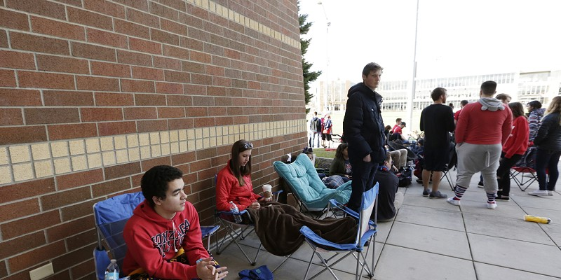 Gonzaga Fans Watch Championship Game At The McCarthey Athletic Center Gonzaga University students 19 year old freshman Joseph Coppock, left, and 21 year old senior Heather Ryan wait at the head of the line at the McCarthey Athletic Center. Both students and their friends have been waiting in line from as early as 6:30AM. Young Kwak