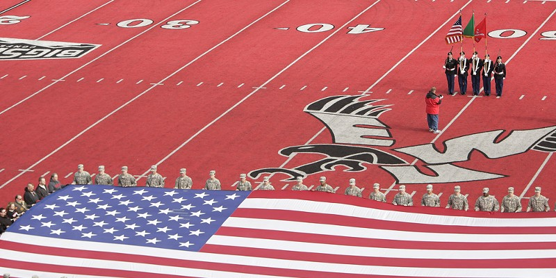 Montana State vs. Eastern Washington Football An American flag is held by Eastern Washington University Army ROTC members and veterans from the school on the field for Military and Veterans Appreciation Day during the playing of the national anthem before the game. Young Kwak