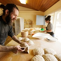 Year In Review: Photos by Young Kwak Head Baker Shaun Thompson Duffy, left, folds some sprouted quinoa and sunflower seed bread as bar Alissa Wilde folds a rustic artisan loaf at Bouzies Bakery, Friday, Feb. 6, 2015, in Spokane, Wash. (Young Kwak/Pacific Northwest Inlander) Young Kwak