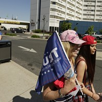 Scenes from Donald Trump's Campaign Rally in Spokane Carla Bonney, left, and her daughter Zhivonna walk towards the Spokane Convention Center before a rally for Republican presidential candidate Donald Trump. Young Kwak
