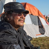 "Scenes from the Dakota pipeline protests Harrison Burnside who goes by ""Trucking Bear"" is a U.S. Army Veteran and full blooded Navajo tribal memeber. He rode his Harley Davidson motorcyle alone for two days twice from Fort Collins CO to the Sacred Stone camp along the Cannonball River in ND. ""I might not have much to offer but at least I can add a body to the stand... make a stand with the protectors. I've already gone home but I came back again after the dog incident. I saw it on Facebook, that's the only news I trust."""