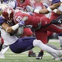 Apple Cup 2016 Washington defensive back Ezekiel Turner, left, brings down Washington State wide receiver Kaleb Fossum (83) during the first half. Young Kwak
