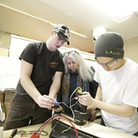 2016 Year in Review: Photos by Young Kwak 17 year old Camden Black, left, and 18 year old Josh Wheeler, right, test a super shifter on a prototype tank drive as Co-Founder Barbara Pleason Mueller looks on, at Gizmo-CDA during a robotics workshop, Thursday, Feb. 4, 2016, in Coeur d'Alene, Idaho. (Young Kwak/Pacific Northwest Inlander) Young Kwak