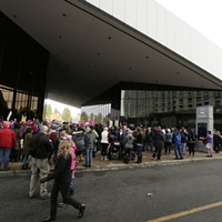 Women's March on Spokane Attendees line up to enter the Spokane Convention Center for the rally. Young Kwak