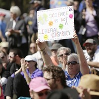 March For Science In Spokane Colleen Egger, from Colville, Wash., holds up her sign while listening to a speaker in Riverfront park. Young Kwak