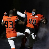 Salt Lake Screaming Eagles vs. Spokane Empire Indoor Football League Game Spokane Empire defensive lineman John Griggs (93) and defensive lineman Harold Love III (99) great each other during introductions before a game against the Salt Lake Screaming Eagles.