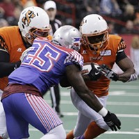 Salt Lake Screaming Eagles vs. Spokane Empire Indoor Football League Game Spokane Empire running back Mulku Kalokoh, right, tries to run the ball around Salt Lake Screaming Eagles linebacker Jerome McElroy (25) during the first half. Young Kwak