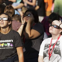 Partial Solar Eclipse in Spokane Bailey Bordelon, left, and Kailyn Hudson watch a partial solar eclipse while wearing their solar glasses, at the Spokane Tribal Gathering Place. Young Kwak