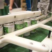 Monthly rewind: 10 unpublished pictures from October Cans of No-Li Brewhouse's Big Juicy IPA are filled with beer on the line of Spokes Mobile Canning. Young Kwak