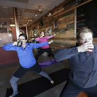 Boga Instructor Sara Murphy, left, and Roz Nix take a drink of their beers during a Boga class at Badass Backyard Brewing in Spokane Valley. Young Kwak