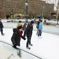 Saturday at the Riverfront Park Ice Ribbon on the Opening Weekend Alex Huylar, left, and her husband Nick Huylar skate. Young Kwak