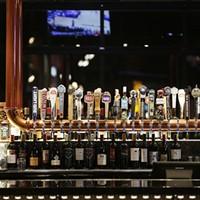 New Slideshow The bar at Three Peaks Kitchen & Bar at the Spokane Tribe Casino. Young Kwak