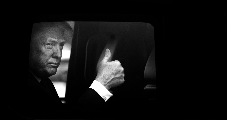 President Donald Trump gives a thumbs up from the presidential SUV before talking to reporters, and then boarding Air Force One, at Joint Base Andrews in Maryland, May 31, 2018. - DOUG MILLS/THE NEW YORK TIMES