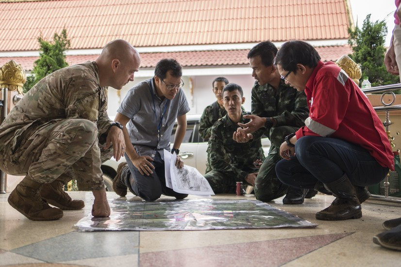 Airmen from the U.S. Indo-Pacific Command meet with Thai military officials to assist in the rescue mission. - AIR FORCE PHOTO BY CAPT. JESSICA TAIT