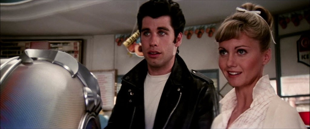 John Travolta and Olivia Newton-John in Grease, which we're screening in Olmsted Park on Aug. 16.