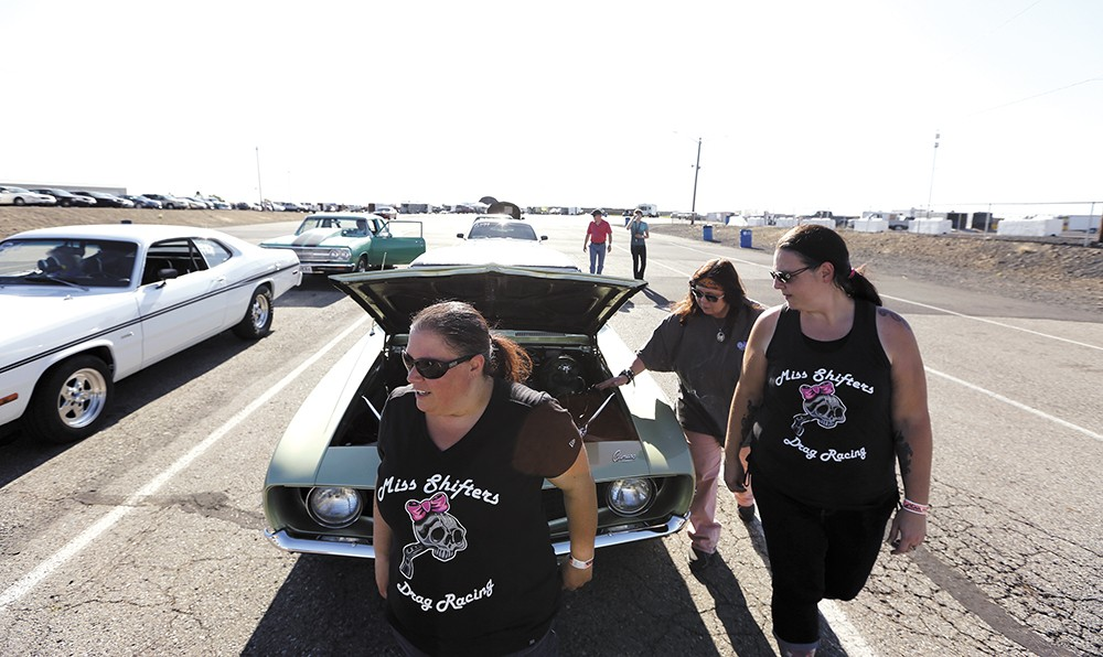 FROM LEFT: Miss Shifters members Shelly Walsh, Annette Callesto and Heather Eller before a Powder Puff time trial, during the Summit #6 Sugar Bear Memorial at the Spokane County Raceway. - YOUNG KWAK